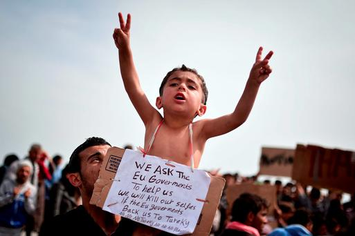Syrian refugees take part in a protest after hundreds of them broke out of the migrant camp on the Greek island of Chios to camp out at the nearby port. Photo: Getty