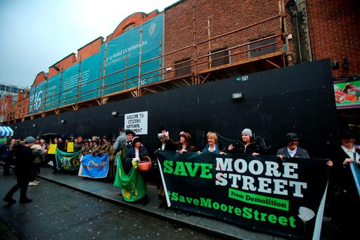 Members of the Save Moore Street 2016 campaign group form a human chain around the street yesterday. Photo: PA