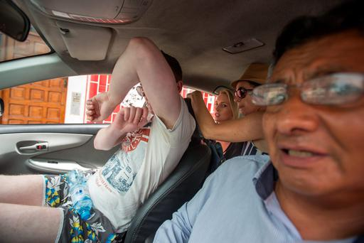 (Back seat on left) An exclusive picture of Michaella McCollum Connolly hiding in a back of taxi with her family after running down side streets from photographers. Pic:Mark Condren