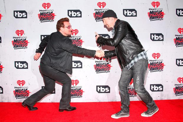 Singer Bono (L) and musician The Edge of U2, winners of the Innovator Award, pose in the press room during the iHeartRadio Music Awards at The Forum on April 3, 2016 in Inglewood, California. (Photo by Jesse Grant/Getty Images for iHeartRadio / Turner)