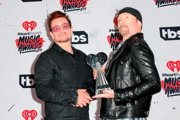 Singer Bono (L) and musician The Edge of U2, winners of the Innovator Award, pose in the press room during the iHeartRadio Music Awards at The Forum on April 3, 2016 in Inglewood, California. (Photo by Frederick M. Brown/Getty Images)