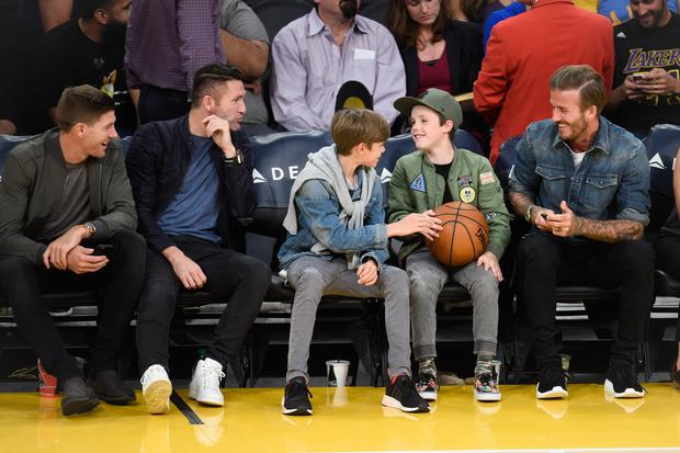 Legendary footballers Robbie Keane (L), David Beckham (C) and Steven Gerrard pose during a basketball game between the Boston Celtics and the Los Angeles Lakers at Staples Center on April 3, 2016 in Los Angeles, California. Keane and Gerrard currently play for the Los Angeles Galaxy. (Photo by Kevork S. Djansezian/GC Images)