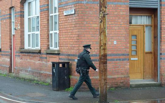 Police at the Scene in Victoria Street in Lurgan Credit: Colm Lenaghan/Pacemaker Press