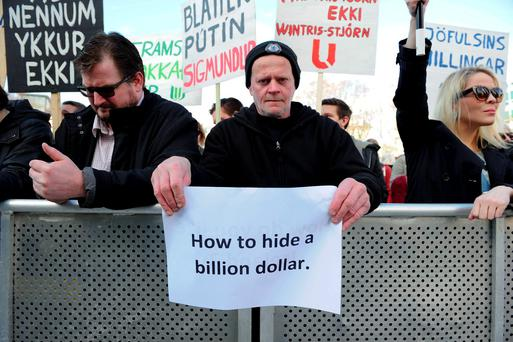 People demonstrate against Iceland's Prime Minister Sigmundur Gunnlaugsson in Reykjavik after a leak of documents stoked anger over his wife owning a tax haven-based company with large claims on the country's collapsed banks. REUTERS/Stigtryggur Johannsson