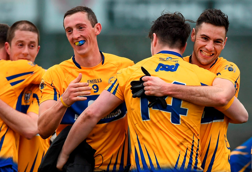 Clare players Cathal O'Connor, Keelan Sexton and Dean Ryan celebrate their promotion to Division 2 in Newbridge. Photo: Sportsfile