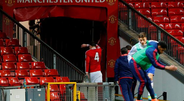 Manchester United's Phil Jones heads straight down the tunnel after being substituted