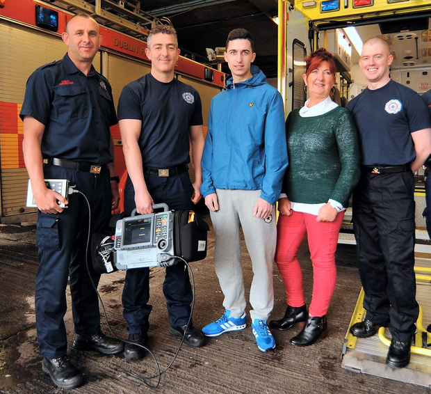 Roberto Rea, from Artane, with his mother June White and firemen Donal Maguire, Donal Brennan, Robert Hedderman, and Kevin Rowe of Dublin Fire Brigade, who saved Roberto's life Photo: Caroline Quinn