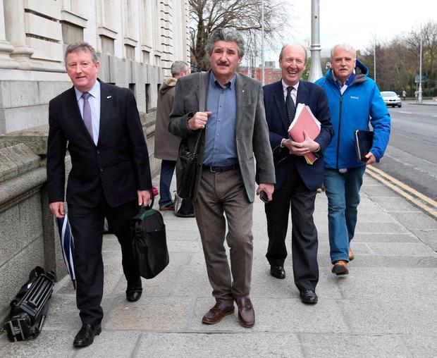 Independent TDs (left to right) Sean Canney, John Halligan, Shane Ross, and Finian McGrath enter Government Buildings to continue talks over the formation of a new government. Photo: Photocall