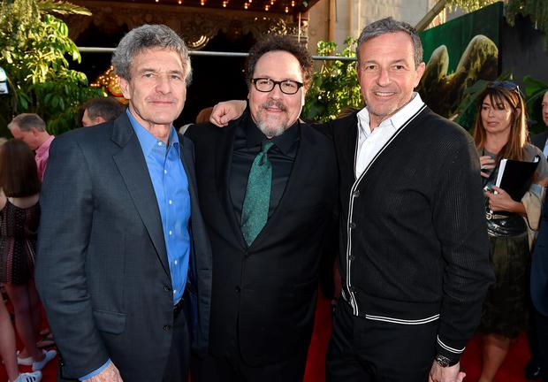 Alan Horn, chairman, The Walt Disney Studios, from left, director/producer Jon Favreau and Bob Iger, chairman and CEO, The Walt Disney Company arrive at the premiere of