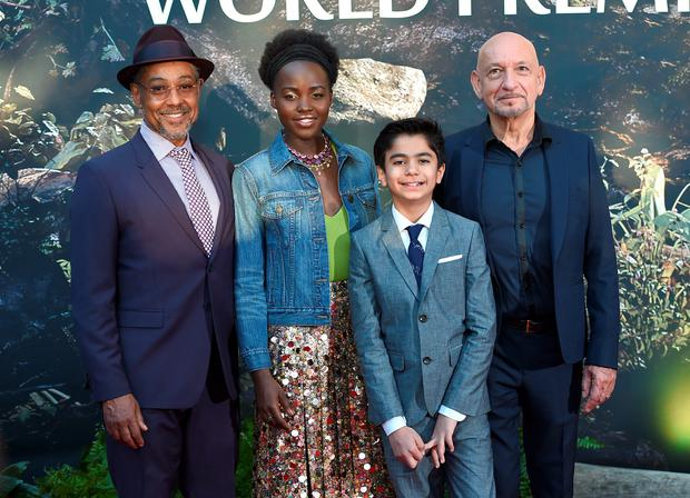 Giancarlo Esposito, from left, Lupita Nyong'o, Neel Sethi and Ben Kingsley arrive at the premiere of