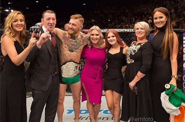 Erin McGregor, standing to the right of Conor, after he clinched the UFC featherweight title against Jose Aldo in December