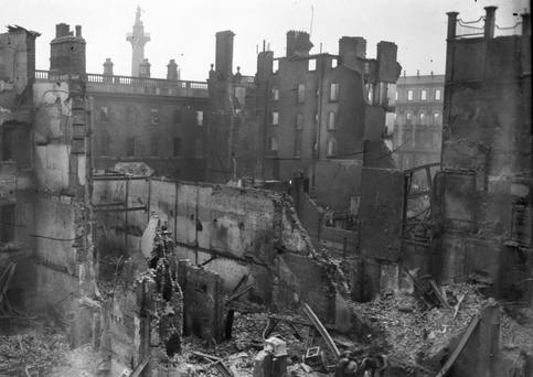 Interior shot of the ruins of the Metropole Hotel at the junction of Sackville (O'Connell) St and Princes St. The GPO is visible to the left and Nelsons Pillar is visible in the background. (Part of the Independent Newspapers Ireland/NLI Collection)