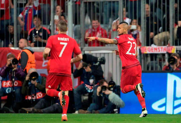 Bayern Munich's Chilean midfielder Arturo Vidal (R) celebrates scoring the opening goal with Bayern Munich's French midfielder Franck Ribery during the Champions League quarter-final, first-leg football match between Bayern Munich and Benfica Lisbon in Munich, southern Germany, on April 5, 2016. / AFP PHOTO / ODD ANDERSENODD ANDERSEN/AFP/Getty Images