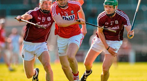 Seamus Harnedy of Cork in action against Galway duo Andrew Smith and Adrian Tuohy during Sunday's Division 1 Relegation Play-off in Pearse Stadium. RAY RYAN / SPORTSFILE