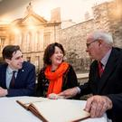 Simon Harris with OPW chairwoman Clare McGrath and Damien Cassidy, Kilmainham Gaol Board of Visitors chairman, as they pay tribute to the gaol's volunteer workers. Photo: Colm Mahady