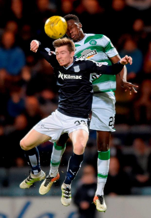 Dundee's Craig Wighton and Celtic's Dedryk Boyata battle for the ball during the match at Dens Park, Dundee. Photo: Jane Barlow/PA