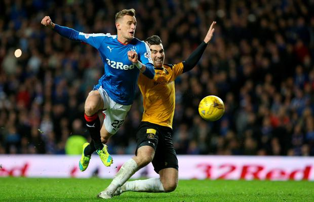 Rangers' Dean Shiels in action against Dumbarton's Gregor Buchananan. Photo: Russell Cheyne/Reuters