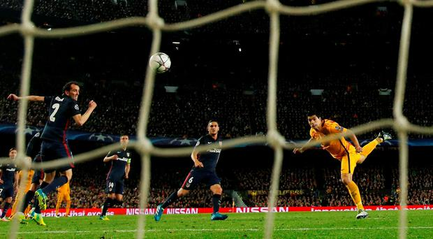 Luis Suarez heads home Barcelona's second goal against Atletico Madrid at the Nou Camp. GETTY