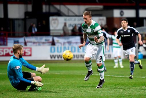 Celtic's Leigh Griffiths is beaten to the ball by Dundee's keeper Scott Bain. Jane Barlow/PA Wire