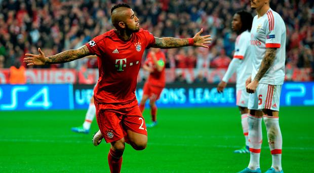 Bayern's Arturo Vidal celebrates after scoring the only goal of the night at the Allianz Arena in Munich. (AP Photo/Kerstin Joensson)