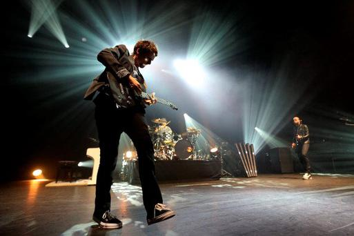 The singer of British rock band Muse, Matthew Bellamy (L) performs on stage on October 2, 2012 at the Olympia concert hall in Paris. THOMAS SAMSON/AFP/GettyImages)