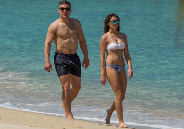 Irish rugby player Ian Madigan and girlfriend Anna Kirwan are spotted on the beach in Barbados. Picture: Chris Brandis-Islandpaps/Splash