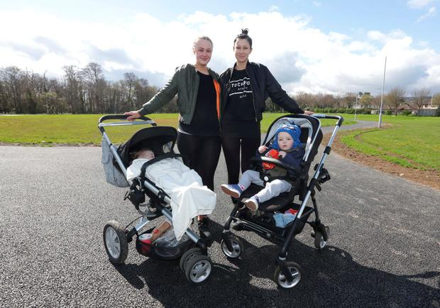 Sisters, Shauna Daly, 22, right, with her son Teddy, and Sophie Daly, 21, with her daughter, Marley, next to a green area beside Shanganagh Wood in Shankill, where an alleged sexual assault took place. Picture credit; Damien Eagers