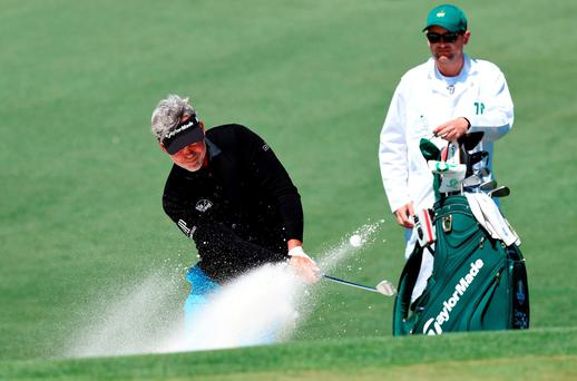 Nothern Ireland's Darren Clarke hits out of a bunker during a practice round prior to the start of the 80th Masters Golf Tournament at the Augusta National Golf Club on April 5, 2016, in Augusta, Georgia. / AFP PHOTO / DON EMMERTDON EMMERT/AFP/Getty Images