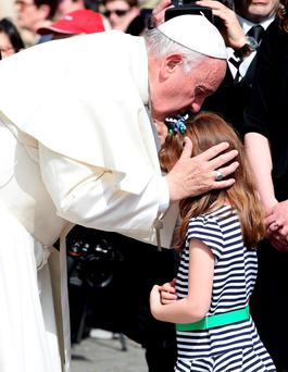 Pope Francis kisses Elizabeth 'Lizzy' Myers, a 5-year-old girl from Ohio, who suffers from a genetic disease known as Usher syndrome, which leads to blindness and hearing loss at the end of the weekly audience in Saint Peter's Square at the Vatican. Reuters/Alessandro Bianchi