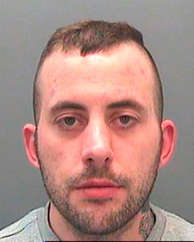 Christian Nicholas, 29, who has been jailed along with two others after being caught throwing drugs into HMP Parc prison near Bridgend Credit: South Wales Police/PA Wire