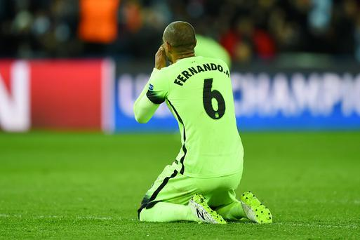 Manchester City's Fernando shows his dejection after his pass hit Zlatan Ibrahimovic of PSG resulting in a goal for the French side. Photo: Getty Images