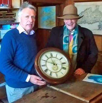 Oliver Mac Donnell and his brother Ron celebrate the return of the clock