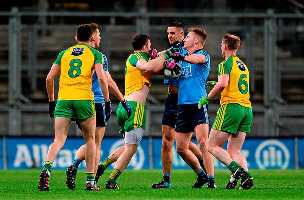 A scuffle breaks out between Dublin and Donegal players during the recent NFL game, which ended with James McCarthy and Michael Murphy being sent off after receiving second yellow cards. Photo: Dáire Brennan / Sportsfile