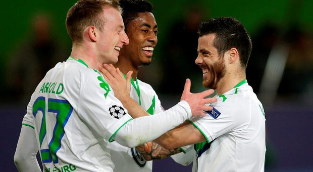 Wolfsburg's Maximilian Arnold celebrates with his teammates Bruno Henrique and Vieirinha after scoring their second goal. Photo: Michael Sohn/AP Photo