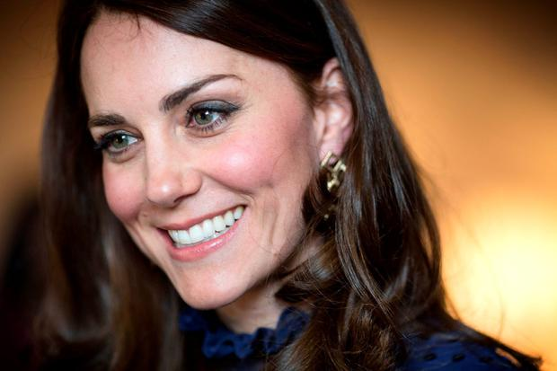 Princess Catherine, Duchess of Cambridge smiles as she attends a reception ahead of their tour of India and Bhutan at Kensington Palace on April 6, 2016 in London, England. (Photo by Warren Allott - WPA Pool/Getty Images)