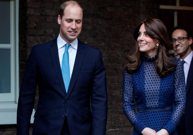Britain's Prince William, Duke of Cambridge (L) and Catherine, Duchess of Cambridge (R), attend a reception at Kensington Palace, London, on the April 6, 2016 ahead of their tour of India and Bhutan.