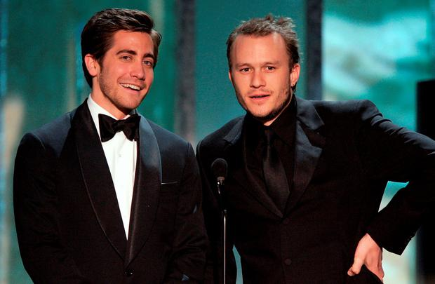 Actor Jake Gyllenhaal and Heath Ledger speak onstage during the 12th Annual Screen Actors Guild Awards held at the Shrine Auditorium on January 29, 2006 in Los Angeles, California. (Photo by Kevin Winter/Getty Images)