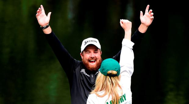 Shane Lowry of Ireland and Wendy Honner react during the Par 3 Contest prior to the start of the 2016 Masters Tournament at Augusta National Golf Club on April 6, 2016 in Augusta, Georgia. (Photo by Harry How/Getty Images)