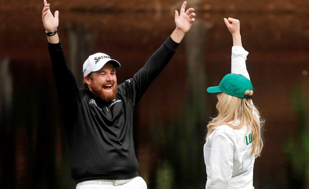 Shane Lowry, of Ireland, reacts after his caddie sank a putt on the ninth hole during the par three competition at the Masters golf tournament Wednesday, April 6, 2016, in Augusta, Ga. (AP Photo/Jae C. Hong)