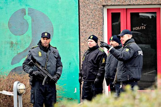 Danish police are seen after searching an apartment in Ishoej, Denmark. (Joachim Adrian/POLFOTO via AP)