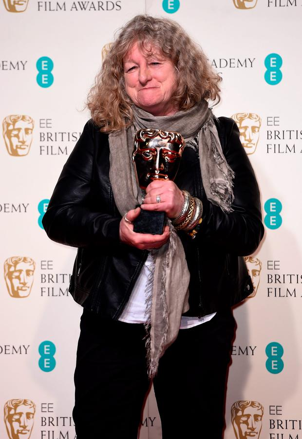 Jenny Beavan poses with the Best Costume Design Award for 'Mad Max: Fury Road poses in the winners room at the EE British Academy Film Awards at the Royal Opera House on February 14, 2016 in London, England. (Photo by Ian Gavan/Getty Images)