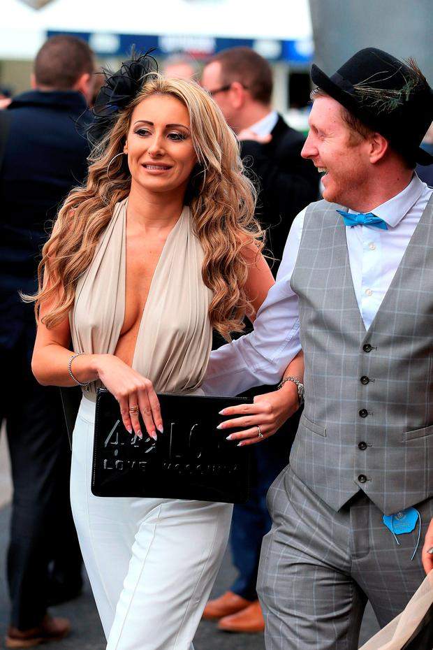 A female racegoer arrives during the Grand Opening Day of the Crabbie's Grand National Festival at Aintree Racecourse, Liverpool. Photo: Mike Egerton/PA Wire