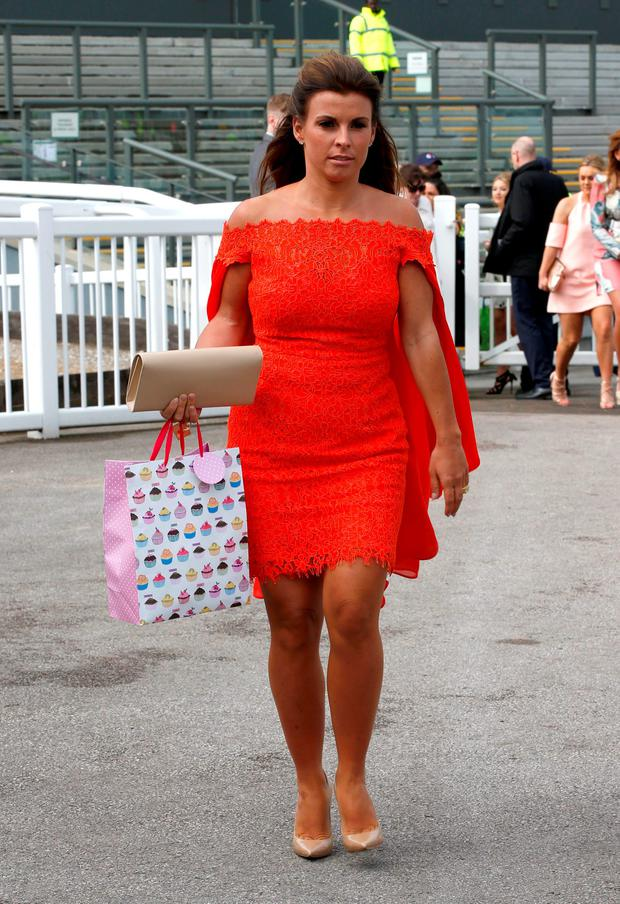 Coleen Rooney arrives for the the Grand Opening Day of the Crabbie's Grand National Festival at Aintree Racecourse, Liverpool