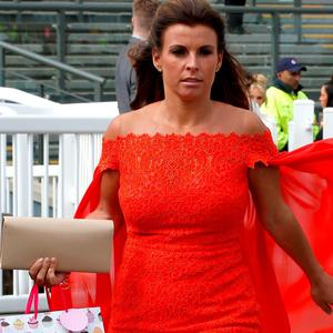 Coleen Rooney arrives for the Grand Opening Day of the Crabbie's Grand National Festival at Aintree Racecourse. Picture: Peter Byrne/PA Wire