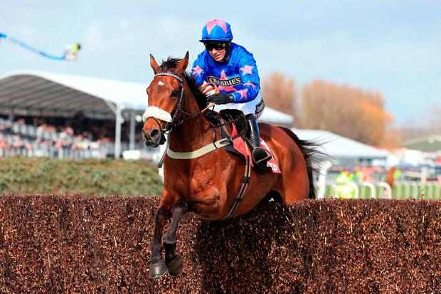 Cue Card ridden by Paddy Brennan on the way to winning the Betfred Bowl Chase during the Grand Opening Day of the Crabbie's Grand National Festival at Aintree