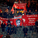 Liverpool's fans show a banner featuring their side's German head coach Jurgen Klopp prior to the UEFA Europe League quarter-final, first-leg football match Borussia Dortmund vs Liverpool FC in Dortmund, western Germany on April 7, 2016. / AFP PHOTO / ODD ANDERSENODD ANDERSEN/AFP/Getty Images