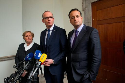 Fine Gael TDs Frances Fitzgerald, Simon Coveney and Leo Varadkar discuss the talks at Leinster House. Photo: Arthur Carron