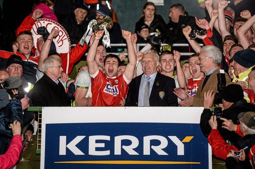 7 April 2016; Cork captain Stephen Cronin lifts the cup after victory over Kerry. EirGrid Munster GAA Football U21 Championship Final, Kerry v Cork. Austin Stack Park, Tralee, Co Kerry. Picture credit: Diarmuid Greene / SPORTSFILE
