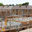 The construction sector is expected to grow by more than a fifth this year. Photo: Bloomberg
