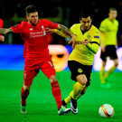 Liverpool's Spanish defender Alberto Moreno (L) and Dortmund's Armenian midfielder Henrikh Mkhitaryan vie for tha ball during the UEFA Europe League quarter-final, first-leg football match Borussia Dortmund vs Liverpool FC in Dortmund, western Germany on April 7, 2016. / AFP PHOTO / John MACDOUGALLJOHN MACDOUGALL/AFP/Getty Images